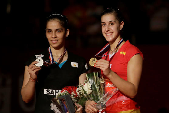 Slide 1 of 16: Spain's Carolina Marin, right, and India's Saina Nehwal pose with their medals during an award ceremony after their women's singles final match at the Badminton World Federation championships at Istora Stadium in Jakarta, Indonesia, Sunday, Aug. 16, 2015. Marin beat Nehwal for gold.