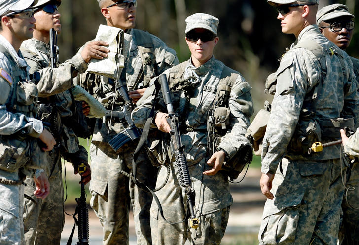 In this photo taken on Aug. 4, 2015, a female Army Ranger stands with her unit during Ranger School at Camp Rudder on Eglin Air Force Base, Fla. According to the Northwest Florida Daily News, she and one other female were the first to complete Ranger training and earn their Ranger tab this week.