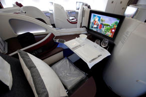 Interior view of the Business Class seats on the second floor deck of the Airbus A380 of Qatar Airways