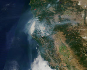 An image taken by NASA's Terra satellite on Aug. 17, 2015, shows five large fires raging through an area in the Shasta-Trinity National Forest, located west of Redding, California. To the north are two additional fires, just south of the Oregon state line. The red pixels are heat signatures detected by the Moderate Resolution Imaging Spectroradiometer (MODIS) instrument onboard NASA's Aqua satellite