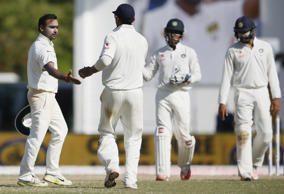India's Amit Mishra (L) celebrates with his teammates after taking the wicket of Sri Lanka's Tharindu Kaushal (not in picture) during the third day of their second test cricket match in Colombo August 22, 2015.