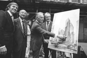 Governor Hugh Carey points to an artists' conception of the new New York Hyatt Hotel/Convention facility that will be build on the site of the former Commordore Hotel, June 28, 1978. At the launching ceremony are, from left: Donald Trump, son of the city developer Fred C. Trump; Mayor Ed Koch of New York; Carey; and Robert T. Dormer, executive vice president of the Urban Development Corp.