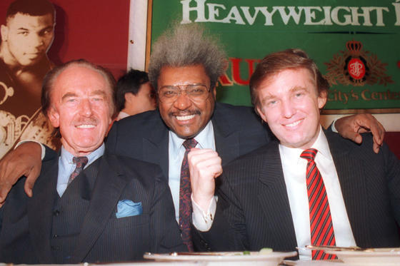 Slide 4 of 22: Donald Trump, right, pictured with his father, Fred Trump, far left, and boxing promoter Don King at a press conference in December 1987 in Atlantic City, N.J.