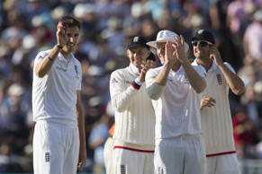 England's Steven Finn, left, celebrates taking his fifth wicket of the day, that of Australia's Mitchell Johnson, caught by Ben Stokes for 14 on the second day of the third Test match of the five match series between England and Australia at Edgbaston