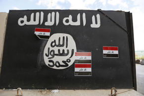 A wall painted with the black flag commonly used by Islamic State militants, File photo.