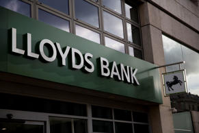 Lloyds first-half profit rises 38 pct, to consider special dividends