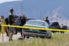 <p>Law enforcement agents investigate the scene of a shooting in Pryor, Mont., on the Crow Reservation on Wednesday, July 29, 2015. The FBI confirmed that two people were killed and a third injured by gunfire in Pryor, a town of just over 600 people in southern Montana. A suspect was arrested hours later in Wyoming, FBI spokesman Todd Palmer said.</p>