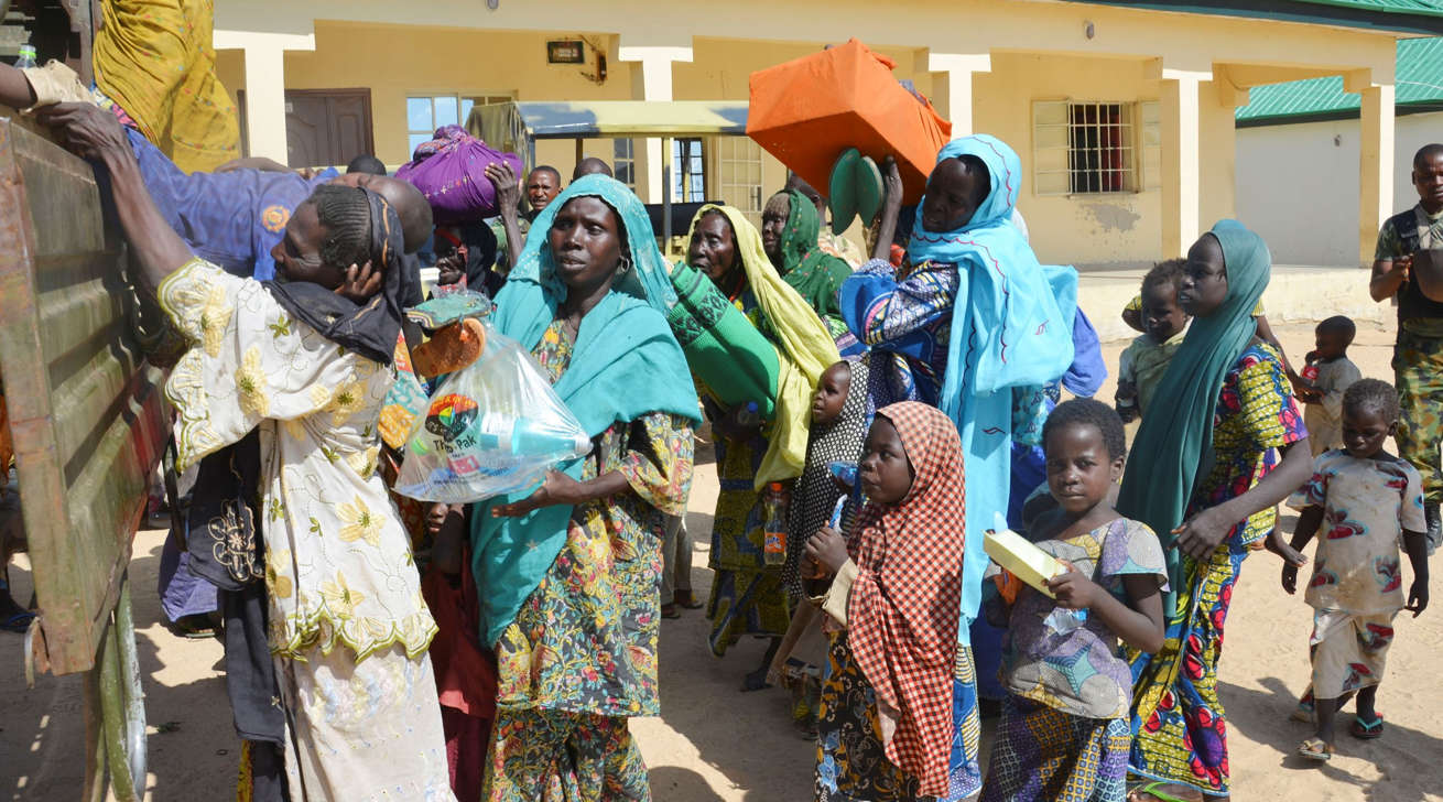 Women and children rescued by Nigerian soldiers from Boko Haram extremists in the northeast of Nigeria arrive at the military office in Maiduguri, Nigeria, Thursday, July 30, 2015. Soldiers rescued 71 people, almost all girls and women, in firefights that killed many Boko Haram militants in villages near the northeastern city of Maiduguri, Nigeria's military said Thursday.