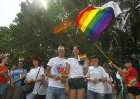 File: Participants attend Vietnam's second gay pride parade in Hanoi August 4, 2013.
