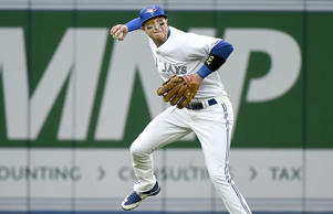 Toronto Blue Jays shortstop Troy Tulowitzki makes a throw against the Philadelphia Phillies June 29 in Toronto.