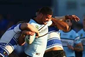 Andrew Fifita of the Sharks is tackled during the round 20 NRL match on July 26, 2015 in Sydney, Australia.
