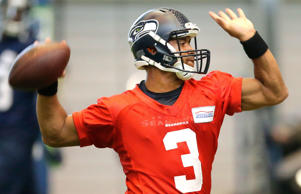 Seattle Seahawks quarterback Russell Wilson throws a pass during an NFL football organized team activity, Tuesday, June 2, 2015, in Renton, Wash.
