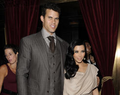 FILE - This Aug. 31, 2011 file photo shows newlyweds Kim Kardashian and Kris Humphries attending a party thrown in their honor at Capitale in New York.
