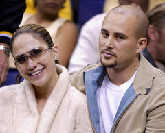 **FILE**Cris Judd and his wife Jennifer Lopez watch the Los Angeles Lakers play ...