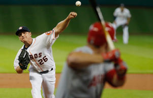 Scott Kazmir of the Houston Astros throws a pitch in the first inning to Mike Trout of the Los Angeles Angels of Anaheim during their game at Minute Maid Park on July 30, 2015 in Houston, Texas.