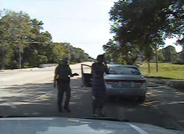 "In this July 10, 2015 file frame from dashcam video provided by the Texas Department of Public Safety, trooper Brian Encinia arrests Sandra Bland after she became combative during a routine traffic stop in Waller County, Texas. Encinia, a Texas trooper who arrested Bland after a confrontation that began with a traffic stop, had been cautioned about ""unprofessional conduct"" in a 2014 incident while he was still a probationary trooper."