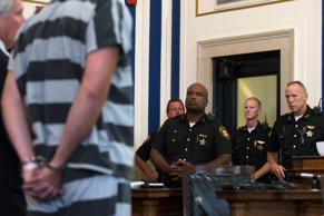 Court officers look on as former University of Cincinnati police officer Ray Tensing, left, appears at Hamilton County Courthouse for his arraignment in the shooting death of motorist Samuel DuBose, Thursday, July 30, 2015, in Cincinnati.