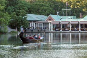 People ride in a gondola on Central Park Lake at The Loeb Boat House Restaurant in Central Park in New York.