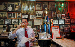 U.S. Republican presidential candidate Scott Walker drinks a glass of beer during a campaign stop at the Billy Goat Tavern in Chicago, Illinois, United States, July 27, 2015.