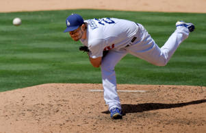 Los Angeles Dodgers starting pitcher Clayton Kershaw throws during the seventh inning of a baseball game against the Los Angeles Angels Aug. 1, 2015, in Los Angeles.