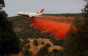 A firefighting airplane drops fire retardant while battling the Rocky Fire in Lower Lake, California. Justin Sullivan/Getty Images