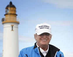 Presidential contender Donald Trump poses for the media during the third day of the Women's British Open golf championship on the Turnberry golf course in Turnberry, Scotland, on Saturday, Aug. 01, 2015.
