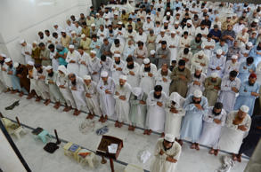 People offer funeral prayers for Taliban leader Mullah Mohammad Omar at a mosque in Peshawar, Pakistan, Friday, July 31, 2015.