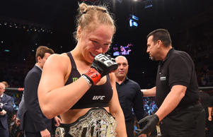Ronda Rousey of the United States celebrates her knockout victory over Bethe Correia of Brazil in the first round in their UFC women's bantamweight championship bout during the UFC 190 event early Sunday in Rio de Janeiro, Brazil.