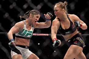 Ronda Rousey (right) punches Bethe Correia during their bantamweight title fight at the UFC 190 event on August 1, 2015, in Rio de Janeiro, Brazil. Rousey knocked out Correia in 34 seconds to retain the title.