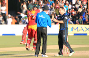 Zimbabwean batsmen Craig Ervine, right, and Sean Williams celebrate after beating New Zealand.