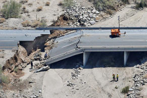 Aerial photo of the collapsed elevated section of Interstate 10 in Desert Center, Calif. Matt York/AP