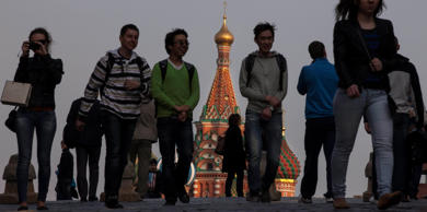 Tourists walk through Red Square in Moscow.