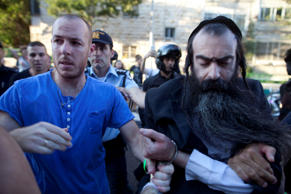 Israeli Policemen arrest an ultra-Orthodox Jewish man suspected of stabbing participants of the Gay Pride Parade on July 30, 2015 in Jerusalem, Israel.
