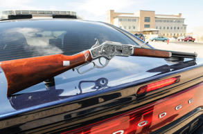 A toy rifle, modeled after an 1894 Winchester, is displayed on the truck of a Las Cruces Police cruiser on Wednesday, April 1, 2015, after it caused panic at Mountain View Regional Medical Center Plaza in Las Cruces, N.M. In New York retailers including Walmart, Sears and Amazon have agreed to keep realistic toy guns off their shelves as part of a settlement with the state.