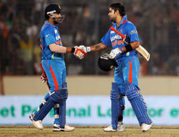 File: India's Rohit Sharma, left, congratulates teammate Virat Kohli on scoring a century during their Asia Cup cricket match against Pakistan in Dhaka, Bangladesh, Sunday, March 18, 2012.