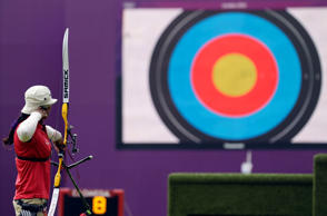 File: India's Deepika Kumari shoots during an elimination round of the individual archery competition at the 2012 Summer Olympics, Wednesday, Aug. 1, 2012, in London.
