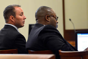 Former Charlotte-Mecklenburg Police Department Officer Randall Kerrick, left, sits with attorney Michael Greene, Monday, July 20, 2015, in Charlotte, N.C., during the first day of his trial. Investigators say Kerrick shot Jonathan Ferrell, who was unarmed, 10 times during an investigation of a possible home invasion.