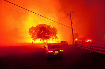 Residents flee as winds whip flames from the Morgan fire along Morgan Territory Road near Clayton, California in unincorporated Contra Costa County September 9, 2013.