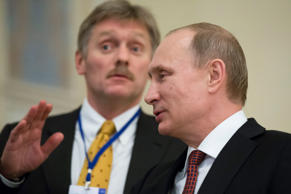 Russian President Vladimir Putin, right, with his press secretory Dmitry Peskov .