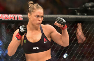 Ronda Rousey looks on prior to her fight against Bethe Correia during UFC 190 at...