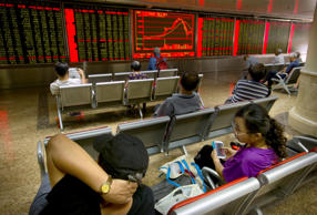 Asian stocks decline as commodities rout sends crude oil lower