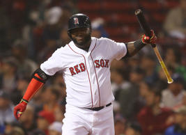 David Ortiz #34 of the Boston Red Sox reacts after missing the ball on a swing against the Atlanta Braves in the ninth inning at Fenway Park on June 15, 2015 in Boston, Massachusetts.