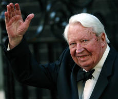 Former British Prime Minister Edward Heath waves as he arrives at number 10 Downing Street in London in this file photo dated April 29, 2002.