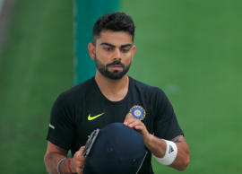 Indian cricket captain Virat Kohli, gets ready to bat during an indoor  practice session in Colombo, Sri Lanka,Tuesday, Aug. 4, 2015. The Indian cricket team is in Sri Lanka to play a three test match series that begins Aug. 12.