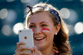 A fan of the United States takes a picture with her iPhone before the USA takes on Colombia in the FIFA Women's World Cup 2015 Round of 16 match at Commonwealth Stadium on June 22 in Edmonton, Canada.