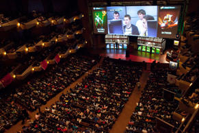 "A packed Benaroya Hall watches ""Natus Vincere,"" pictured on the screen, battle ""The Alliance"" during ""The International"" Dota 2 video game competition in Seattle, Washington August 11, 2013."