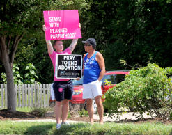 Andrew Ward, left, and Bill Pauls discuss their positions on abortion Tuesday, July 28, 2015 during a rally across the street from the Planned Parenthood of Kansas and Mid-Missouri in Columbia, Mo.