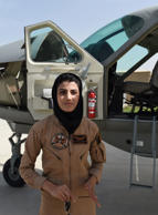File: In a picture taken on April 26, 2015, Afghanistan's first female pilot Niloofar Rahmani, 23, poses for a photograph alongside a fixed-wing Afghan Air Force aviator aircraft in Kabul.
