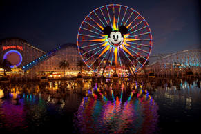 Mickey's Fun Wheel is photographed at dusk in Disney California Adventure Park i...