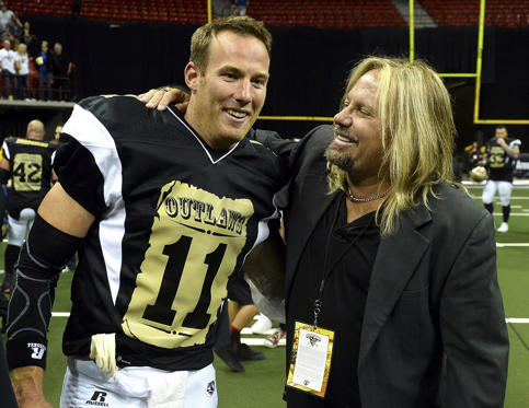 LAS VEGAS, NV - MAY 04:  Quarterback J.J. Raterink #11 of the Las Vegas Outlaws is congratulated by Motley Crue singer and team owner Vince Neil after the Outlaws defeated the Los Angeles Kiss 49-16 during their game at the Thomas & Mack Center on May 4, 2015 in Las Vegas, Nevada.  (Photo by Ethan Miller/Getty Images)